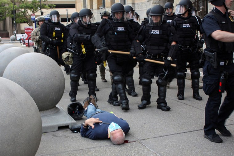 Image: Martin Gugino, a 75-year-old protester, lies on the ground after he was shoved by two Buffalo police officers during a protest against the death in Minneapolis police custody of George Floyd in Niagara Square in Buffalo, New Yor