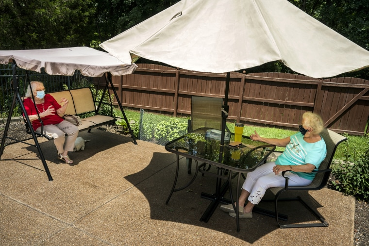 Image: Two senior women wearing face masks social distancing. The best party tents and canopies perfect for hosting outdoor gatherings in 2021. Shop the best gazebo tents, canopy tents and more.
