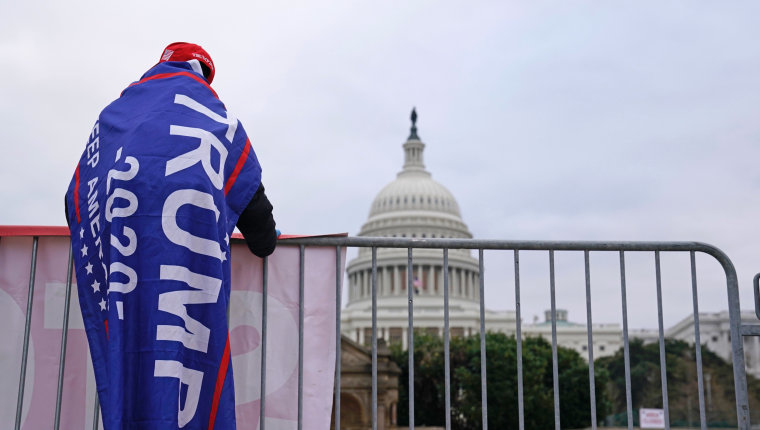 Supporters of President Donald Trump arrive for a rally on the Ellipse outside of the White House on Jan. 6, 2021.