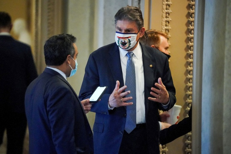 Senator Joe Manchin, D-W. Va., speaks to a reporter outside the Senate Chamber on Feb. 13, 2021.