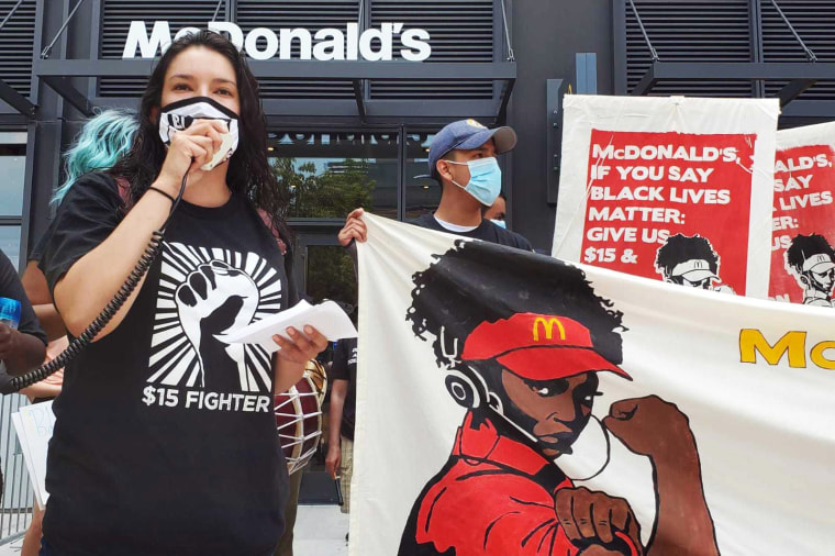 Image: Adriana Alvarez protests outside a McDonald's.