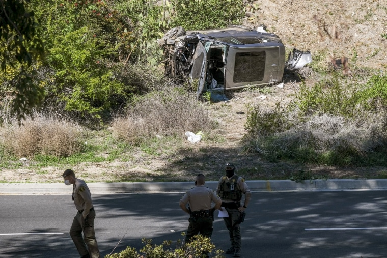 Image: A vehicle rests on its side after a rollover accident involving golfer Tiger Woods along a road in the Rancho Palos Verdes section of Los Angeles on Feb. 23, 2021.
