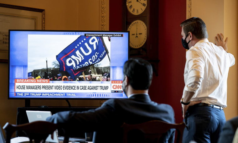 Image: House impeachment managers watch the first day of proceedings in the Senate trial of former President Donald Trump from a room in the Capitol in Washington