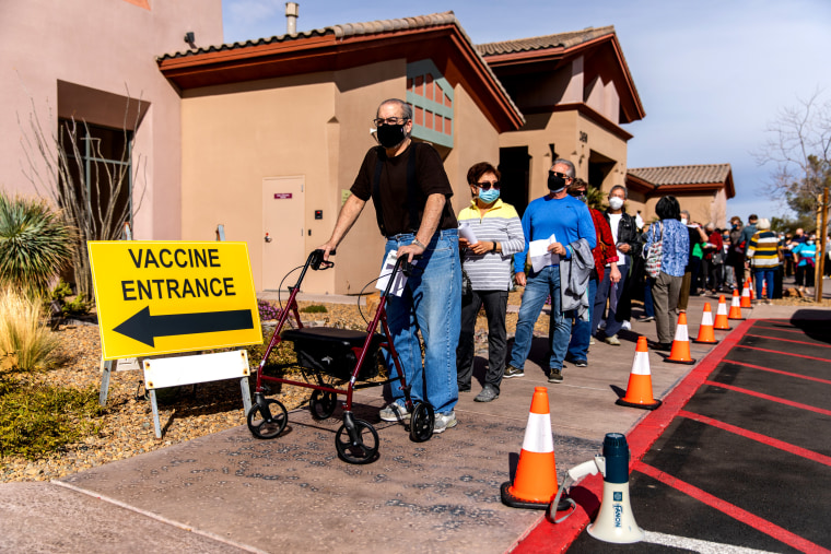 Image: People wait to receive a dose of the Pfizer-BioNTech Covid-19 vaccine in Henderson, Nev., on Feb. 11, 2020.