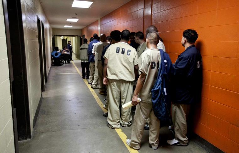 Inmates at the Cook County Jail in Chicago line up to be processed for release on Sept. 29, 2011.