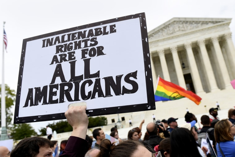 Protesters gather outside the Supreme Court in Washington where the Supreme Court is hearing arguments in the first case of LGBT rights on Oct. 8, 2019.
