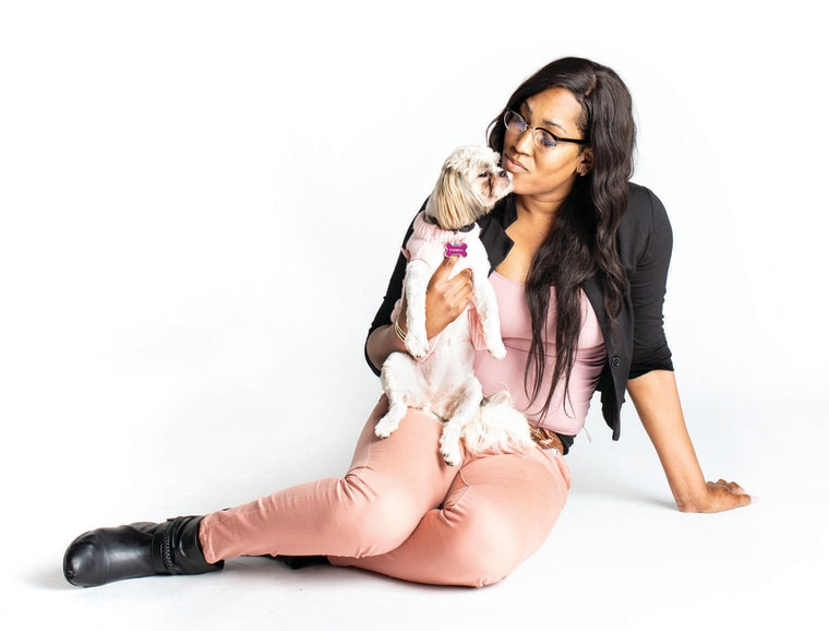 Saanti and her dog, Dutchess.