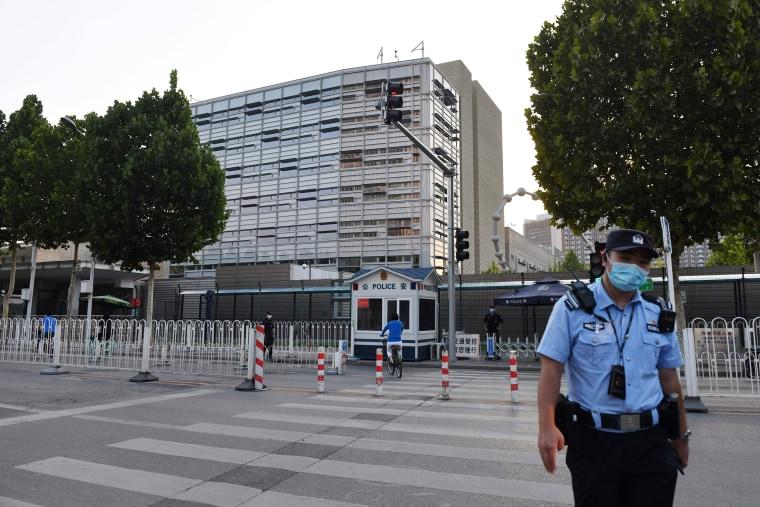 Image: A policeman patrols outside the U.S. embassy in Beijing