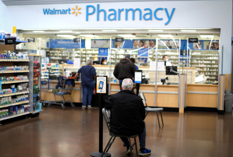 Image: A person waits at a Walmart Pharmacy where the Moderna vaccine is available as Walmart and other major U.S. pharmacies take part in the Federal Retail Pharmacy Program, to increase vaccinations in the U.S. in West Haven, Conn.