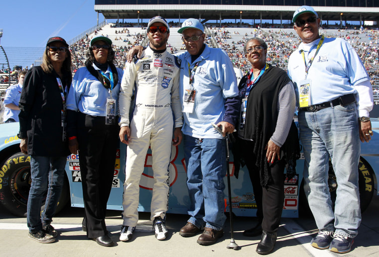 Sybil Scott, Janis Davis, Wendell Scott, Cheryl Ashley and Frank Scott pose with Darrell Wallace Jr., driver of the #34 2015 NASCAR Hall of Fame Inductee Wendell Scott Toyota, during pre-race ceremonies for the NASCAR Camping World Truck Series