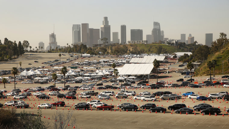 Vehicles wind their way through the parking lots at Los Angeles Dodger Stadium for Covid-19 vaccinations which is one of the largest vaccination sites in the country, on Feb. 25, 2021.