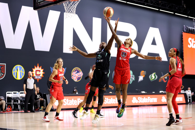 Jocelyn Willoughby #13 of the New York Liberty and Courtney Williams #10 of the Atlanta Dream reach for the ball during the game on Sept. 3, 2020 at Feld Entertainment Center in Palmetto, Fla.