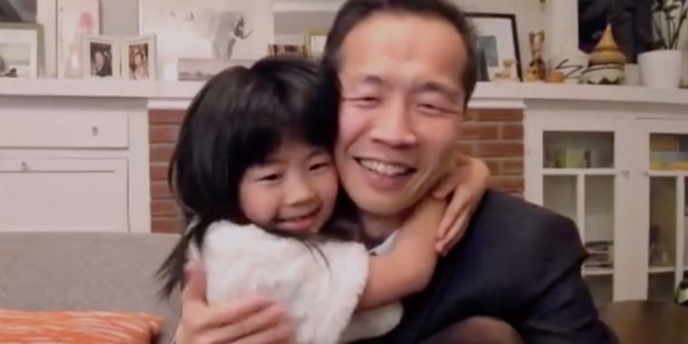 Lee Isaac Chung's 7-year-old daughter hugs her dad during Golden Globes