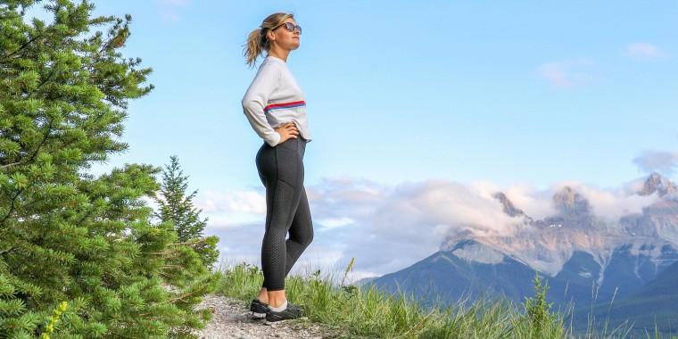 Woman walking outside wearing flattering leggings