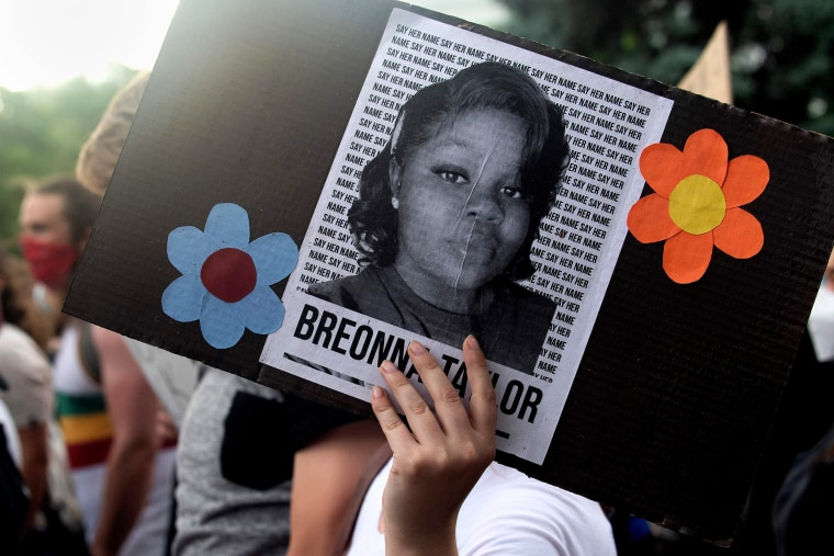 A demonstrator holds a sign with the image of Breonna Taylor in Denver on June 3, 2020.