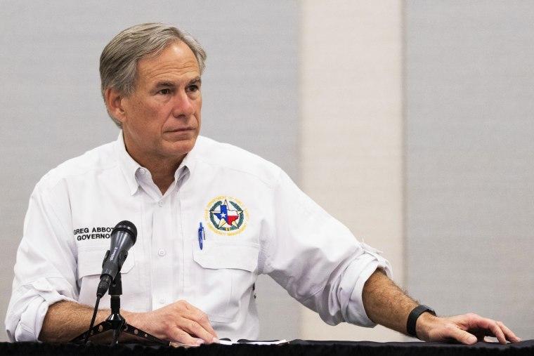 Image: Texas Gov. Greg Abbott visits Lake Jackson on Sept. 29, 2020.