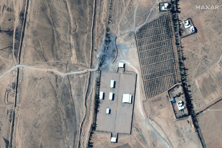 Image: An Iraq-Syria border crossing and destroyed buildings after airstrikes seen on a Feb. 26, 2021 satellite image.