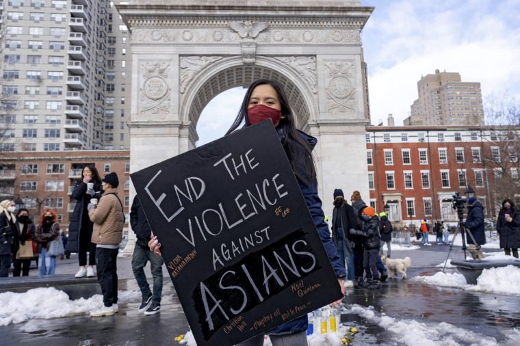 A woman holds a sign at the End The Violence Towards Asians rally in Washington Square Park on Feb. 20, 2021 in New Yor.