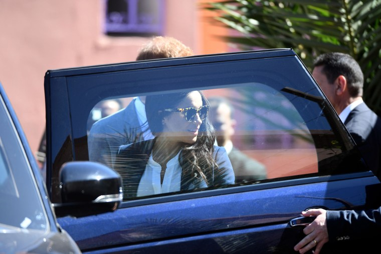 Image: Meghan, Duchess of Sussex, gets into a car after a tour of the Education For All boarding house