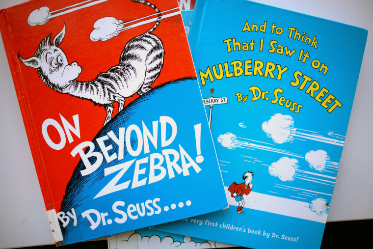 "Image: Books by Theodor Seuss Geisel, aka Dr. Seuss, including ""On Beyond Zebra!"" and ""And to Think That I Saw it on Mulberry Street,"" at the Chinatown Branch of the Chicago Public Library"