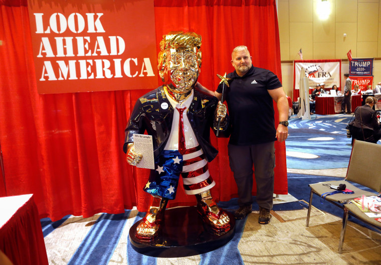 Image: gold statue of former President Donald Trump at CPAC