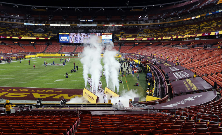 Image: Washington Football Team players run onto the field prior to the game against the Tampa Bay Buccaneers at FedExField