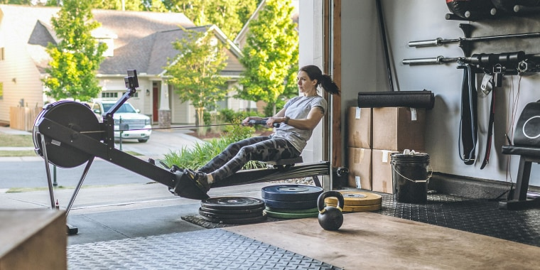 Woman rowing on her at-home rower in her garage. These are the best affordable rowers all under $500. Use this guide to help you find the best rower for your home from Amazon, Walmart and more.