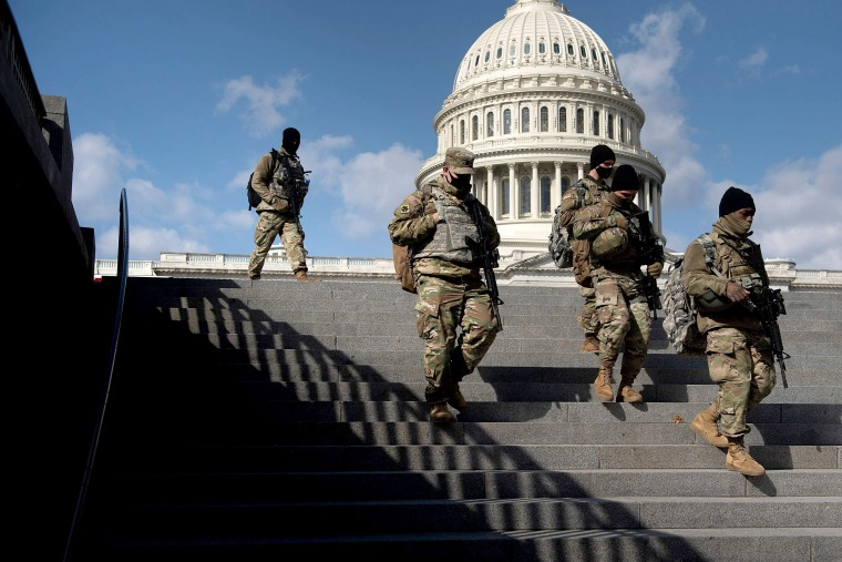 Image: Members of the National Guard patrol the grounds of the Capitol on March 4, 2021, in Washington, DC.