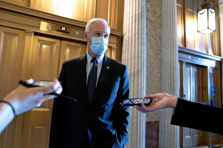 Senator Ron Johnson, R-Wisc., speaks to members of the media while departing the Senate Chamber at the U.S. Capitol on March 3, 2021.