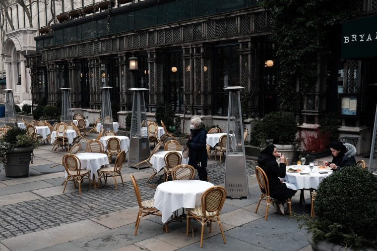 Image: Empty tables at a restaurant in Manhattan on March 1, 2021 in New York City.