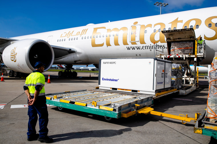 Image: Container RAP81400PC holding the AstraZeneca COVID-19 vaccine is removed from the Emirates airlines plane as the first vaccination doses into the country arrives at Sydney International airport