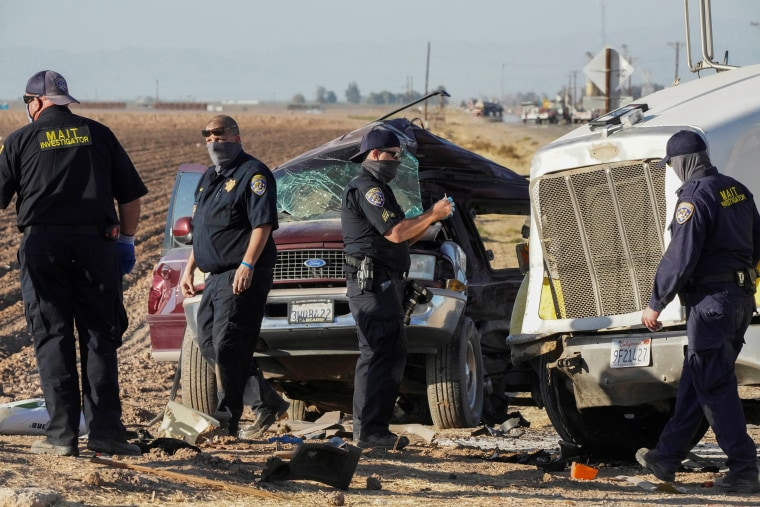 Image: Members of the Multidisciplinary Accident Investigation Teams inspect the scene of a collision between an SUV and a tractor-trailer truck near Holtville