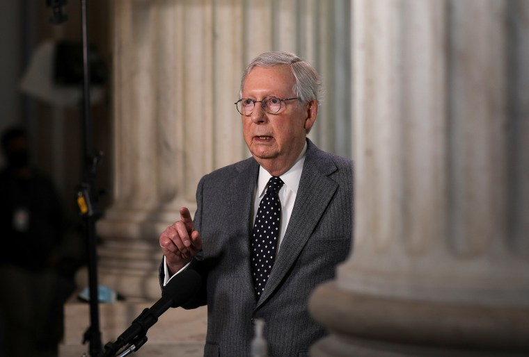Image: Senate Minority Leader Mitch McConnell is interviewed on Capitol Hill in Washington