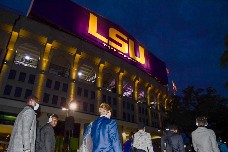 The LSU Tigers walk toward Tiger Stadium to face the Alabama Crimson Tide on Dec. 5, 2020 in Baton Rouge, La