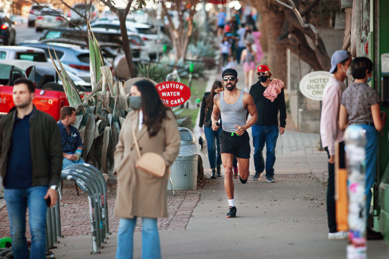 Image: People walk down South Congress Avenue on March 3, 2021 in Austin, Texas.