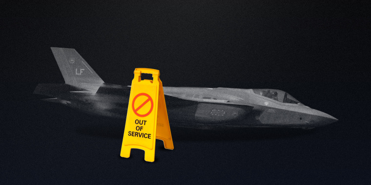 """Photo illustration of the F-35 II Lightning aka the Joint Strike Fighter in a dim room next to a yellow sign that reads,\""""OUT OF ORDER\""""."""