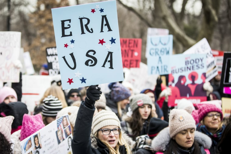 """A marcher holds a sign that say, """"ERA USA"""" during the Woman's March in New York City on Jan. 18, 2020."""