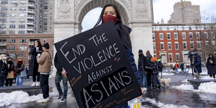 A woman holds a sign at the End The Violence Towards Asians rally in Washington Square Park on Feb. 20, 2021, in New York.