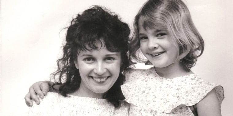 Drew Barrymore and Henry Thomas file photos