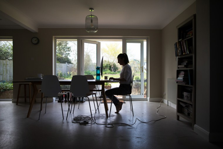 Image: An employee works from home in Stow Maries, U.K., on April 8, 2020.