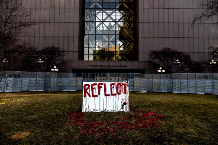 Image: A protest art piece created by Visual Black Justice outside of the Hennepin County Government Center before jury selection begins in the trial of former Minneapolis police officer Derek Chauvin on March 8, 2021.
