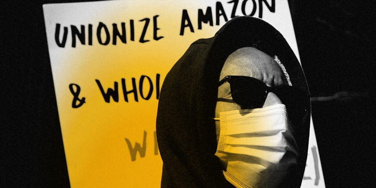 Image: A supporter of Amazon workers at a protest in New York on March 4, 2021.