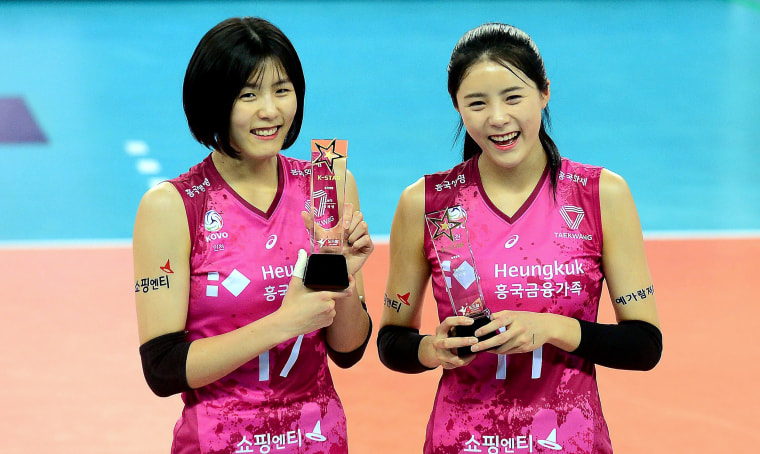 Image: South Korean women volleyball twin stars Lee Jae-yeong, left, and Lee Da-yeong of the Heungkuk Life Insurance Pink Spiders posing after they selected as All-Stars before a V-League game at a gymnasium in Incheon