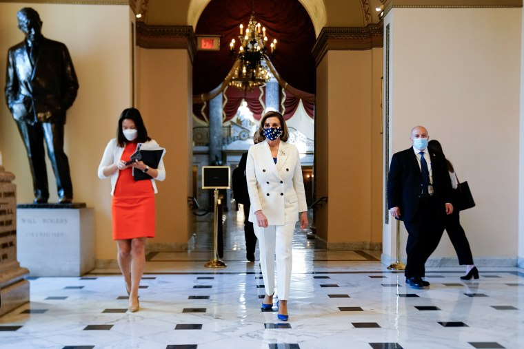 Image: Speaker of the House Pelosi walks to the House floor for the final vote on President Biden's coronavirus (COVID-19) relief bill at the U.S. Capitol in Washington