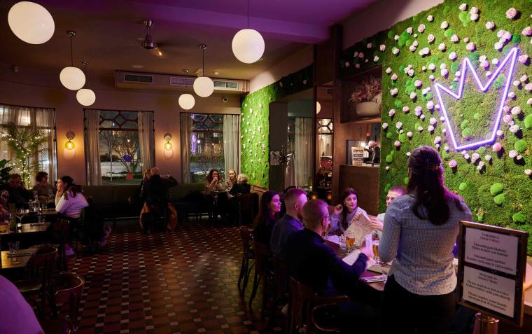 Image: People sit in a restaurant in Reykjavik, Iceland