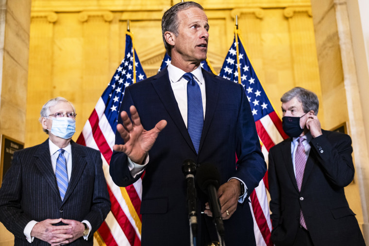 Senate Minority Whip John Thune, R-S.D., talks alongside Senate Minority Leader Mitch McConnell, R-Ky., and Sen. Roy Blunt, R-Mo., on Capitol Hill on March 2, 2021.