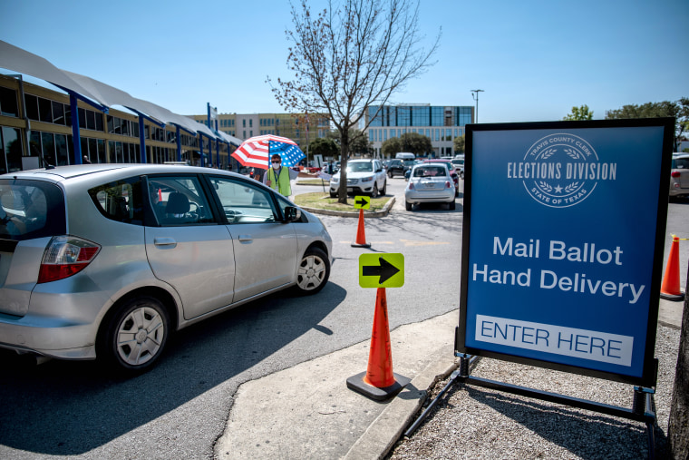 A car arrives at the parking lot of a drive-thru mail ballot hand delivery center in Austin, Texas, on Oct. 2, 2020.