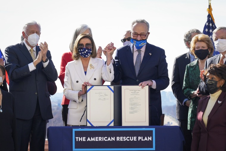 Speaker of the House Nancy Pelosi and Senate Majority Leader Chuck Schumer sign the $1.9 trillion Covid-19 relief bill during a bill enrollment ceremony at the Capitol on March 10, 2021.