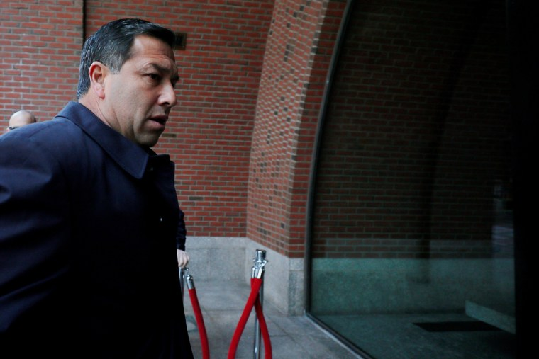 Image: Jorge Salcedo arrives at the federal courthouse in Boston
