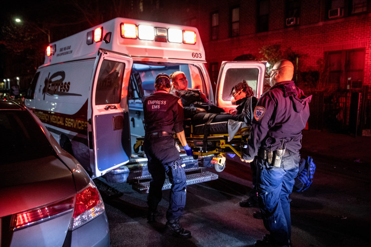 Empress EMS Capt. AJ Briones at an emergency scene as medics load a patient into an ambulance on April 22, 2020 in Yonkers, N.Y.
